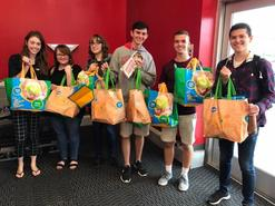 Students using reusable bags from Kroger